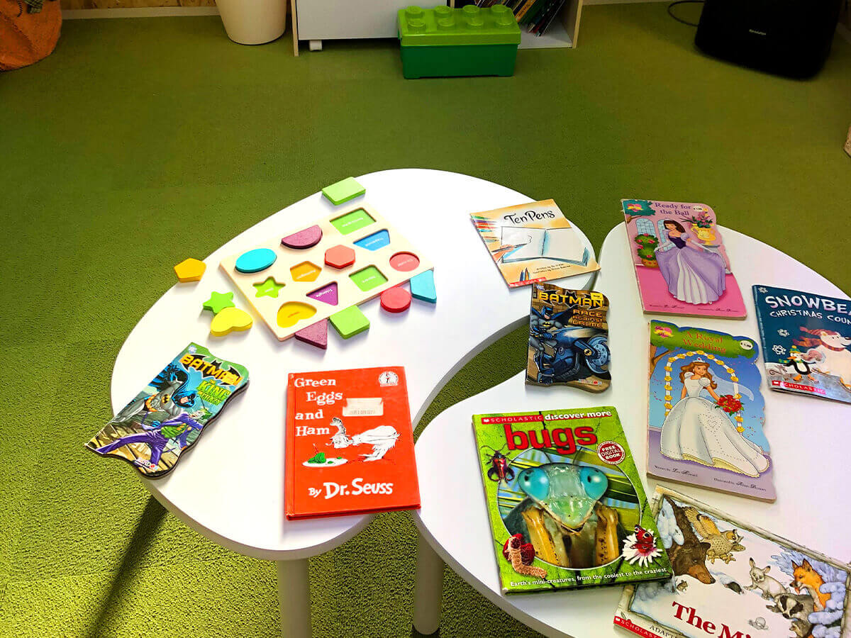 American picture books and toys at waiting room.